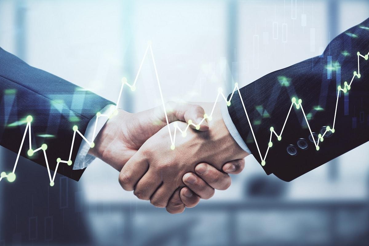 men handshaking over DISH Wireless partnership